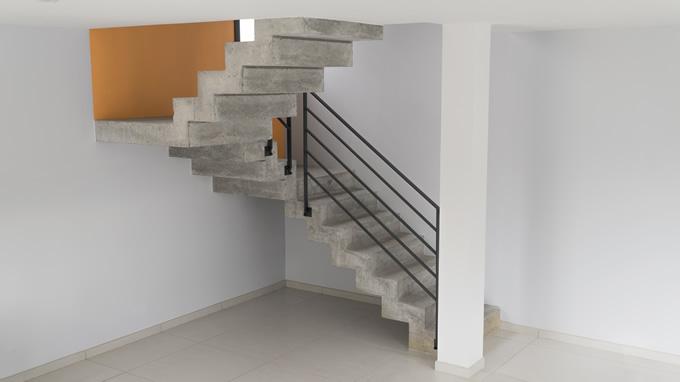 Très belle intégration d'un escalier avec palier dans un salon